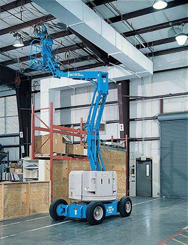 Worker fixing ceiling on a scissor lift